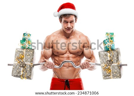 Muscular Santa Claus doing exercises with gifts isolated over white background - stock photo