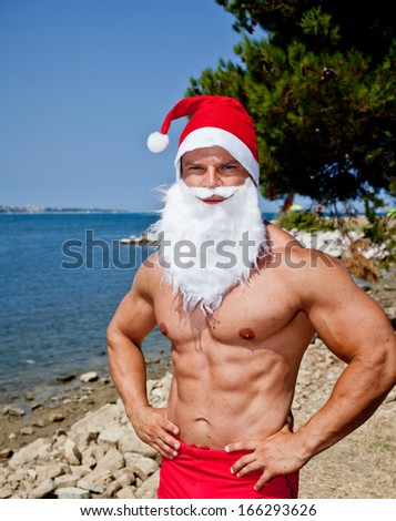 muscular santa claus in summer holiday - stock photo