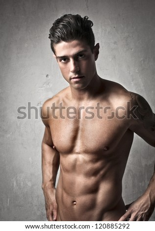 Muscular shirtless man - stock photo