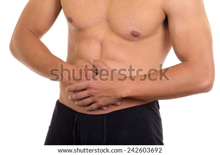 muscular shirtless man with stomach pain isolated on white