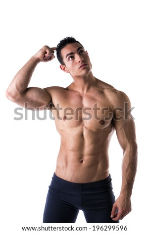 Muscular shirtless young man unsure or confused, scratching head with finger - stock photo