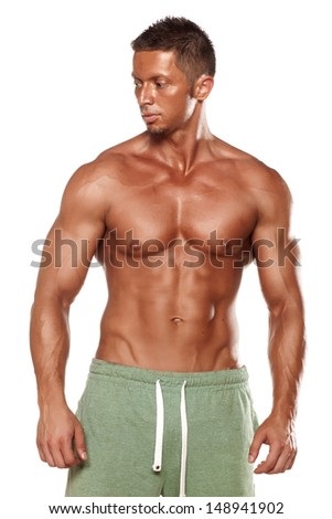 muscular super-high level handsome man posing on white background - stock photo
