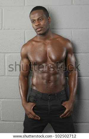 Muscular topless black male - stock photo