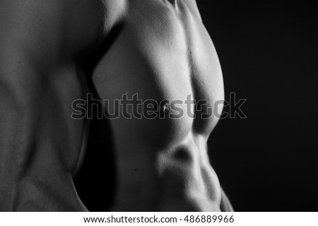 Muscular torso of young man black and white