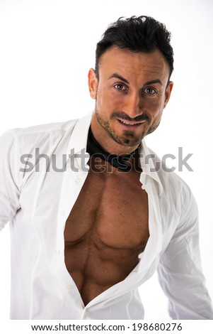Muscular young businessman with shirt open on naked ripped torso, smiling. isolated - stock photo