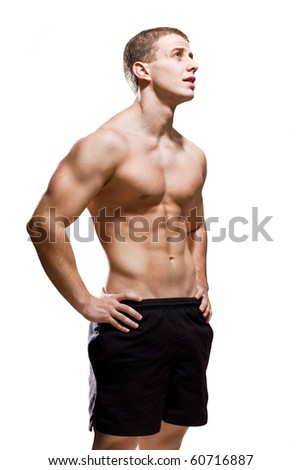 Muscular young male on white background - stock photo