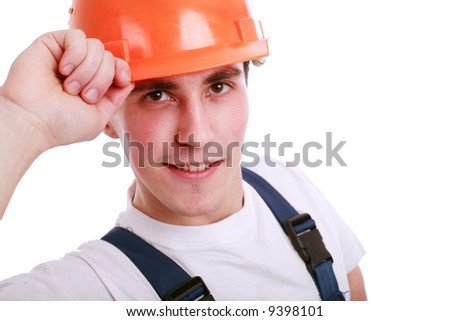 Muscular young man in a builder uniform with tools.
