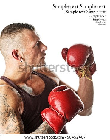 muscular young man in boxing gloves, ready to fight - stock photo
