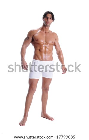 Muscular young man standing bare chested in white boxer brief style underwear - stock photo