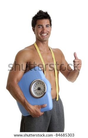 Muscular young man with weight scale