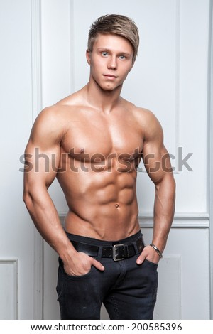 Muscular young naked sexy athlete posing in jeans - stock photo