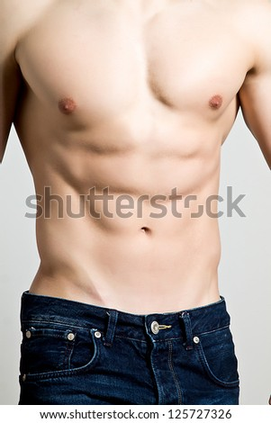Muscular young sexy naked - stock photo