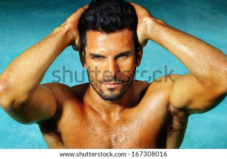 Muscular young sexy naked cute man posing  - stock photo