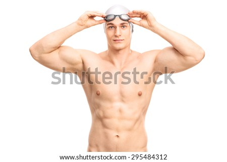 Muscular young swimmer with a gray swim cap and black swimming goggles looking at the camera and smiling isolated on white background - stock photo
