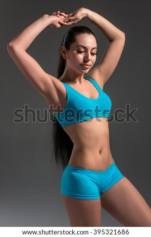 Muscular young woman athlete standing