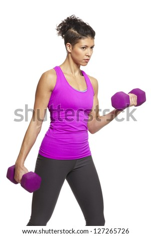 Muscular young woman exercising in sports outfit with dumbbells on white background - stock photo