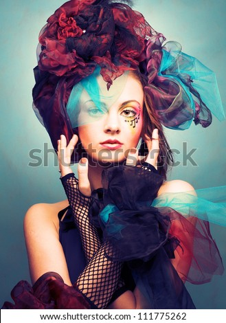 Muse. Romantic portrait of young woman with bright creative make-up in fantastic hat - stock photo
