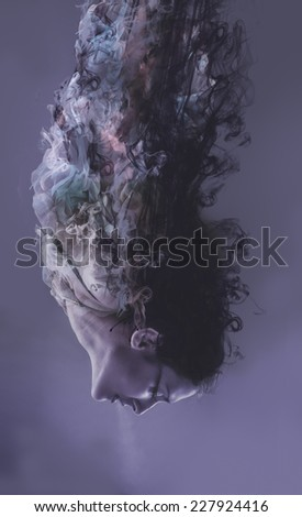 Muse, woman flying with smoke, fantasy concept - stock photo