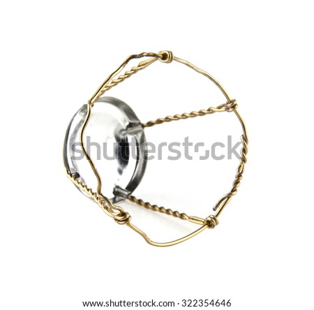 muselet from bottle of champagne on white background - stock photo