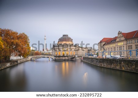 Museum island on Spree river and Alexanderplatz TV tower in center of Berlin, Germany. Blue hour - stock photo
