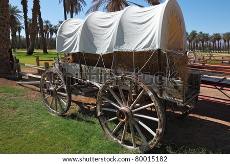 Museum open-air. Ancient vehicle of the first settlers in an oasis in Death Valley - stock photo