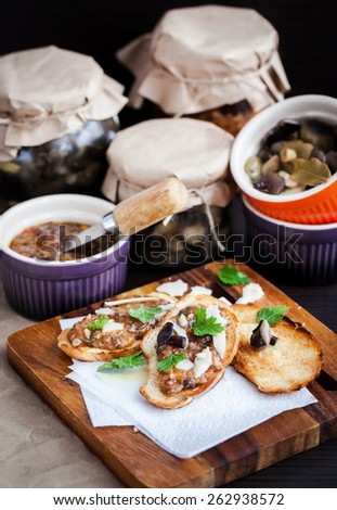 Mushroom and parmesan bruschetta appetizer on wooden board