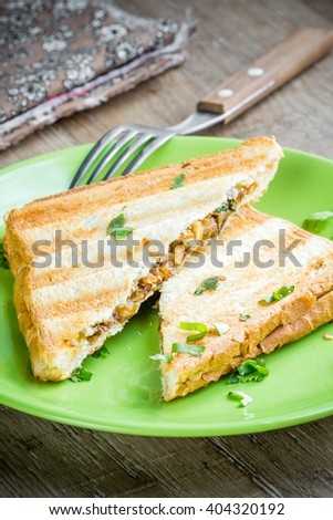 Mushroom cheese sandwich on grill, delicious snack, tatsy breakfast - stock photo