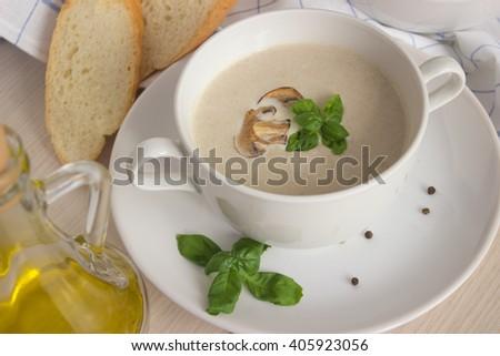 Mushroom cream soup on a table, food - stock photo
