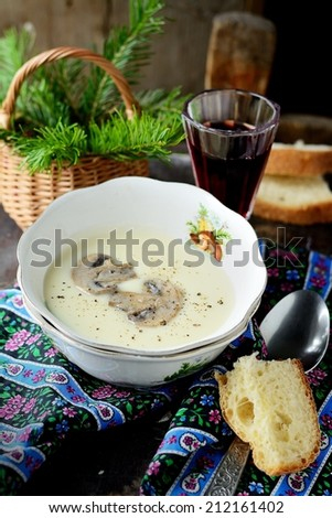 Mushroom cream soup with croutons and thyme in a white bowl - stock photo