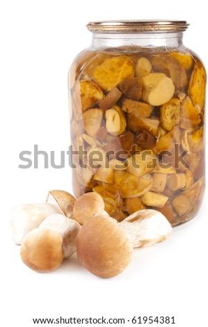 Mushroom. Glass jar of preserved mushroom isolated in white - stock photo