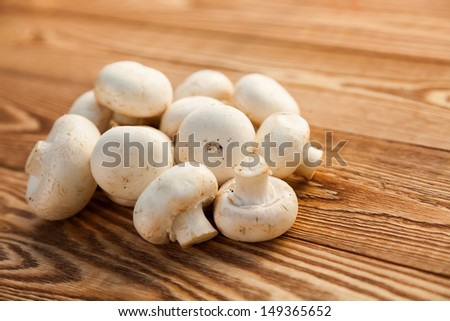 Mushrooms on a wooden background - stock photo