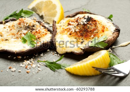 ... four cheeses and topped with crispy panko bread crumbs - stock photo