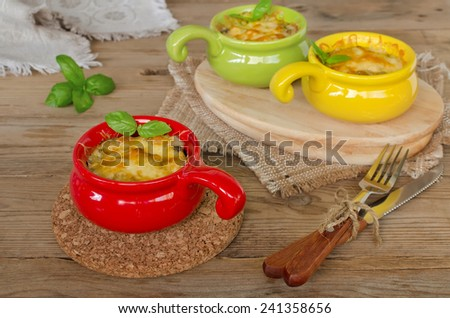 Mushrooms with chicken baked with cheese crust in the cocotte - stock photo