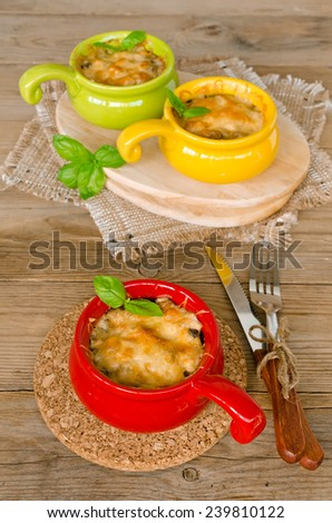 Mushrooms with chicken baked with cheese crust on wooden table - stock photo