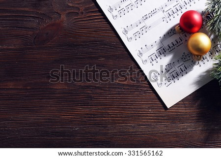 Music and Christmas decor on wooden table - stock photo