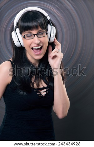music and fun - woman singing with headphone  - stock photo