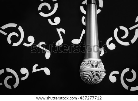 music concept the microphone on note sheets paper stand background. - stock photo