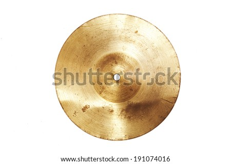 Music conceptual image. Close up of an old cymbal on isolated background. - stock photo
