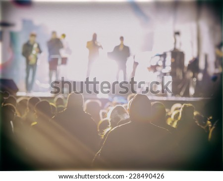 music concert in the street at night blurred background - stock photo