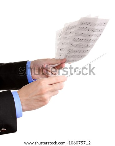 Music conductor hands with baton and notes isolated on white - stock photo