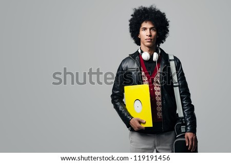 Music dj portrait with afro and headphones isolated on grey background