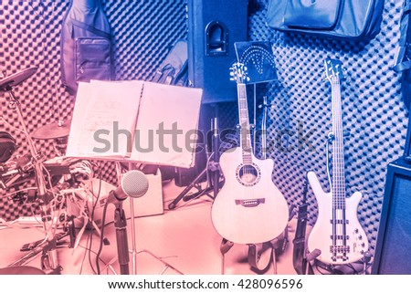 Music equipment background concept.selective focus microphone and blur musical equipment guitar,lyrics,drum,bass,background.music background.music band.music instruments.music equipment. - stock photo