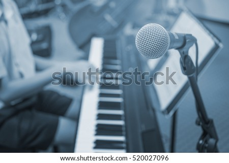 music equipment,microphone and piano player blue tone