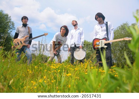 Music group of four in park - stock photo