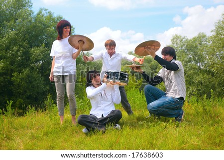 Music group playing in park - stock photo