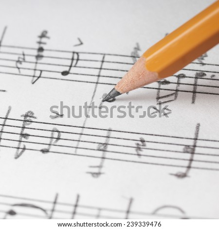 Music notes and pencil, shallow DOF - stock photo