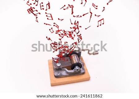 music notes flying out of music box on white background - stock photo