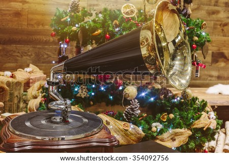 Music on New Year. Christmas tree, gramophone and decoration - stock photo