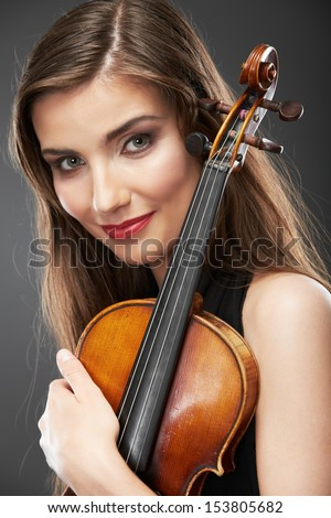 Music portrait of young woman.  Violin play. Close up face beautiful model.