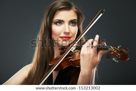 Music portrait of young woman.  Violin play.Female beautiful model.